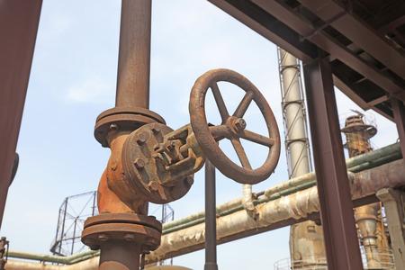 metal pipes: handwheel and metal pipes, closeup of photo Stock Photo