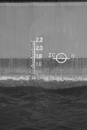 depth measurement: closeup of waterline marked on a ship