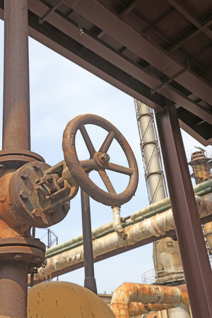 oxidation: handwheel and metal pipes, closeup of photo Stock Photo