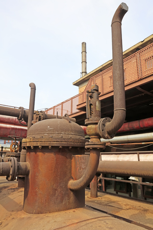 oxidize: oxidize pipe branch in a factory, closeup of photo