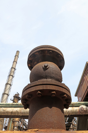 oxidize: oxidize metal fasteners and chimneys in the factory, closeup of photo