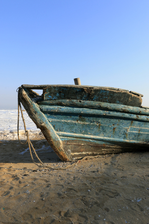 hardship: Wooden boats on the beach, closeup of photo Stock Photo
