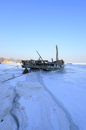 Wooden boats in ice and snow, closeup of photo Stock Photo