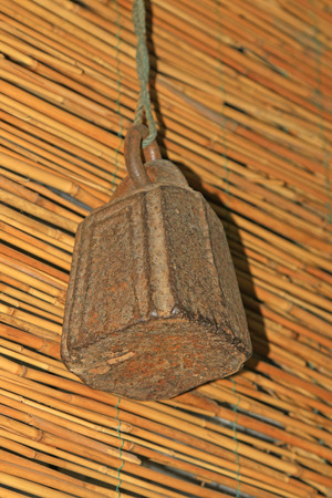 counterpoise: Weight and reed screen, closeup of photo Stock Photo