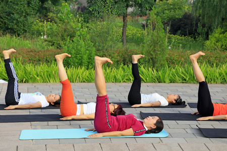 tangshan city: Tangshan - July 3: women doing yoga exercise in the park, July 3, 2016, tangshan city, hebei province, China