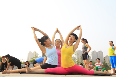 hebei: Tangshan - July 17: women doing yoga exercise in the park, July 17, 2016, tangshan city, hebei province, China