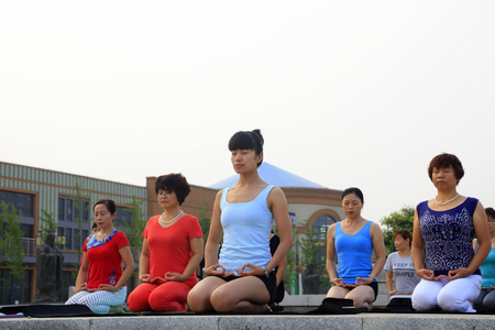 tangshan city: Tangshan - July 17: women doing yoga exercise in the park, July 17, 2016, tangshan city, hebei province, China