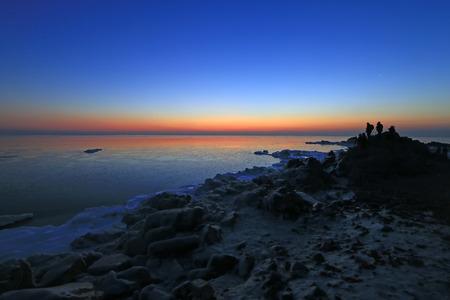 polar environment: photographers shooting seaside scenery, beidaihe, China Stock Photo