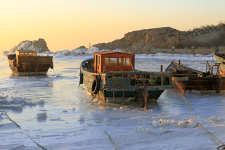 wooden boat in sea ice Stock Photo