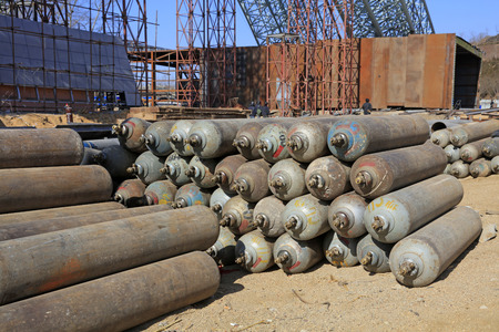 compressed: Steel frame and compressed gas cylinders in a construction site Editorial
