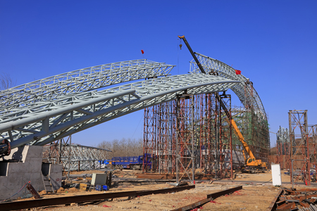 Truss girder and crane on the construction site