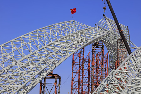 arms trade: Truss girder and crane under blue sky
