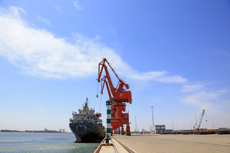 Caofeidian - April 17: cargo ships and tower crane on the freight terminal, on April 17, 2016, caofeidian, hebei province, China Editorial
