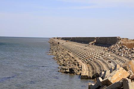 breakwater: Concrete breakwater on a dock, closeup of photo