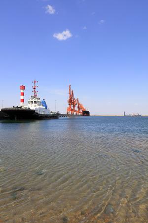 cargo berth under blue sky, closeup of photo