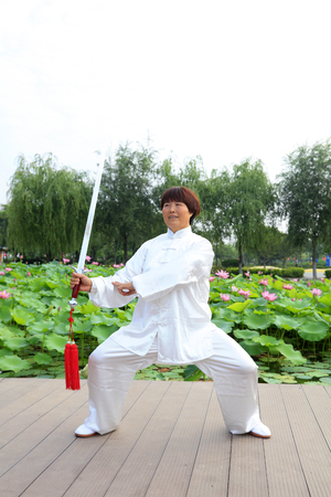 fighting styles: LUANNAN COUNTY - July 16: people practicing taichi on July 16, 2016, Luannan county, Hebei Province, China Editorial