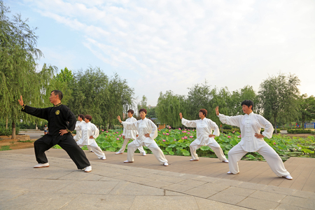 taichi: LUANNAN COUNTY - July 16: people practicing taichi on July 16, 2016, Luannan county, Hebei Province, China Editorial