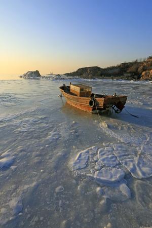 predicament: wooden boat in sea ice Stock Photo