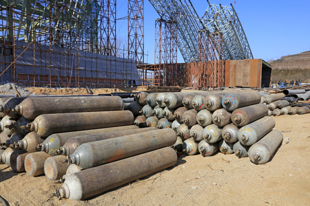 cylinders: Steel frame and compressed gas cylinders in a construction site Editorial