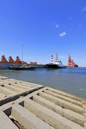 Concrete breakwater in a freight terminal, closeup of photo