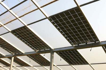 metal structure: solar greenhouses, solar pv glass in a farm Stock Photo