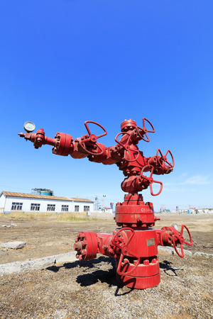 red oil pipeline valve, closeup of photo