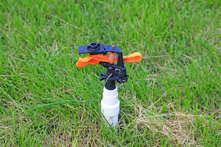 automatically: sprinkler irrigation equipment in lawn Stock Photo