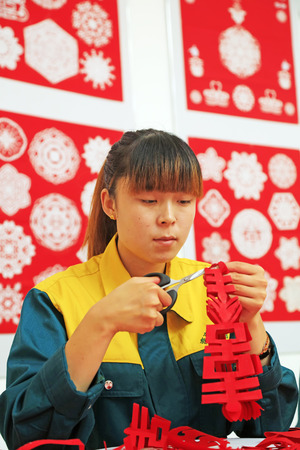 auspicious element: Luannan county - May 13: women making paper-cut works, on May 13, 2016, Luannan county, hebei province, China. Editorial