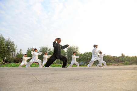 taiji: LUANNAN COUNTY - July 16: people practicing taichi on July 16, 2016, Luannan county, Hebei Province, China Editorial