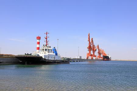 berth: cargo berth under blue sky, closeup of photo