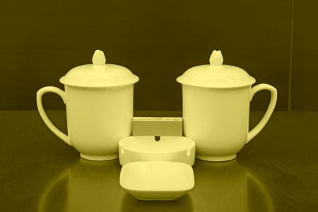 Ceramic cups ashtray, closeup of photo