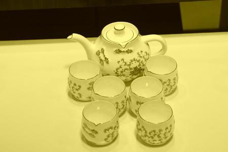 lifelike: Ceramic tea set on a white background, closeup of photo
