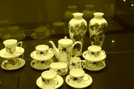 workmanship: Ceramic teapot on the desk, closeup of photo