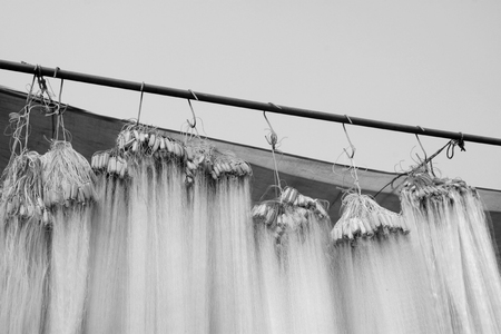 fishing nets: suspension of fishing nets in the market, closeup of photo