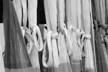 redes de pesca: suspension of fishing nets in the market, closeup of photo