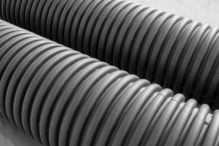 kunststoff rohr: Black plastic pipe, closeup of photo Lizenzfreie Bilder