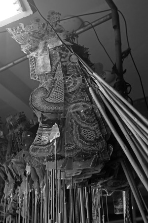 nonphysical: Chinese shadow play props hanging in the night, closeup of photo Stock Photo