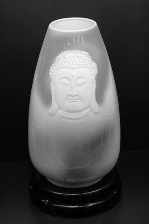 lifelike: buddha figure on ceramic arts and crafts, closeup of photo Editorial