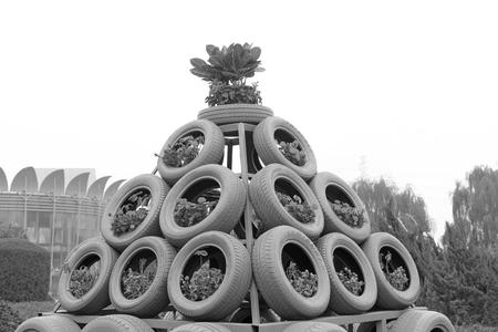 BEIJING - OCTOBER 23: Rubber tire modelling landscape in a garden, on october 23, 2014, Beijing, China. Editorial