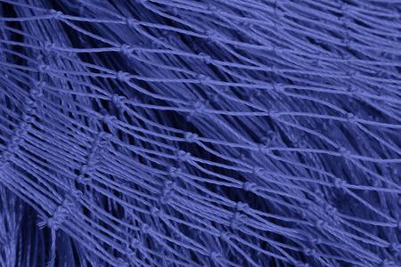 toughness: Nylon fishing nets in a market, closeup of photo
