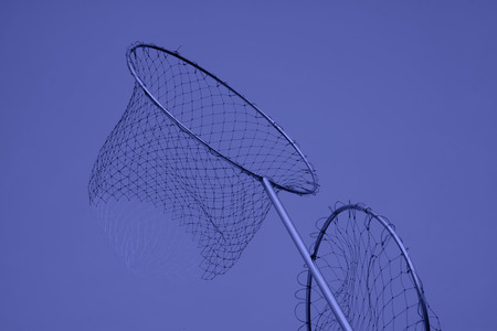 Nylon fishing nets in a market, closeup of photo