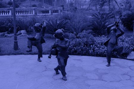 lifelike: Children statue in a park, closeup of photo Stock Photo