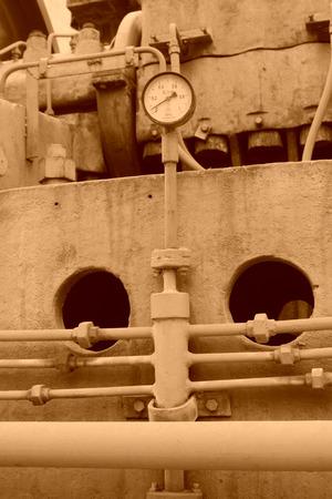 Instrumentation: metal piping and instrumentation, closeup of photo