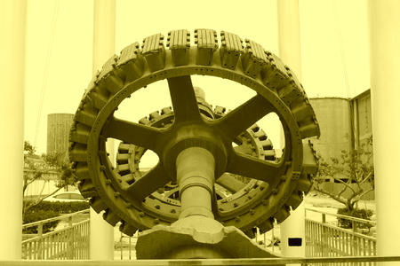 industrial park: Big gear in an industrial park, closeup of photo
