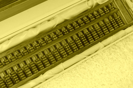 restore ancient ways: Chinese style wooden abacus, closeup of photo Stock Photo