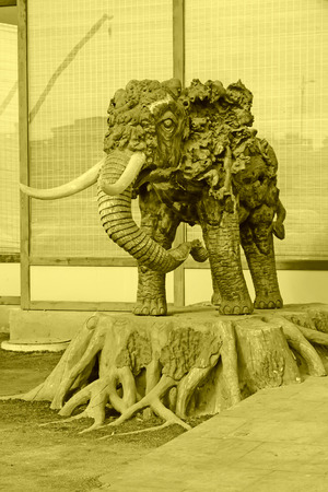 restore ancient ways: Wooden elephant sculptures closeup of photo Stock Photo