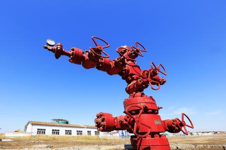 red oil pipeline valve, closeup of photo