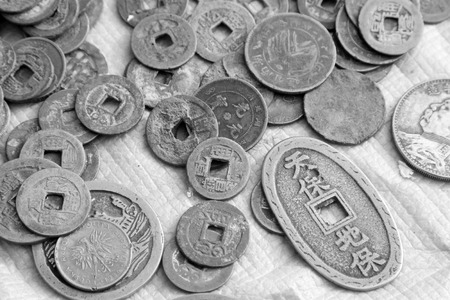 confiscated: Chinese ancient metal currency, closeup of photo