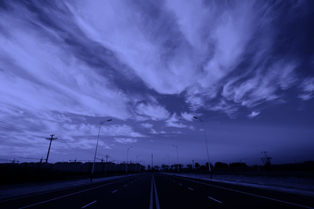 new roads under blue sky and white clouds, closeup of photo