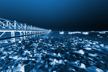 Wooden trestle in ice and snow, closeup of photo Stock Photo